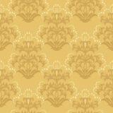 花卉金黄无缝的墙纸 库存图片