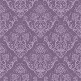 花卉紫色无缝的墙纸 免版税库存图片