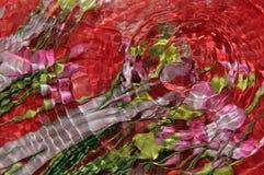 花和水在红色 免版税图库摄影