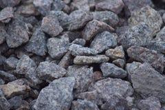 花岗岩向背景扔石头 库存照片
