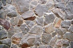 花岗岩石墙当背景纹理 库存照片