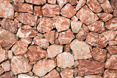 花岗岩粗砺的墙壁 库存图片