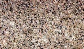 花岗岩纹理,与黑和灰色斑点的红色基地 库存图片