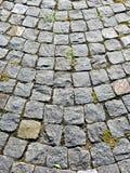 花岗岩铺有鹅卵石的路面纹理 免版税库存图片