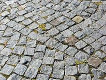 花岗岩铺有鹅卵石的路面纹理 免版税库存照片
