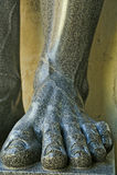 花岗岩雕塑的腿 库存照片