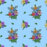 花明亮的花束在蓝色背景的 无缝的模式 免版税库存照片
