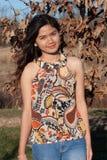 花梢橙色礼服顶层的妇女 免版税图库摄影