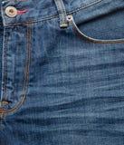 花梢蓝色牛仔裤关闭  免版税库存照片