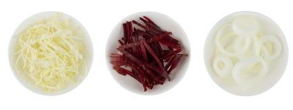 花椰菜、甜菜根和葱在白色碗 库存照片