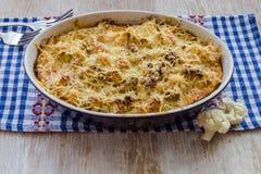 花椰菜烘烤用鸡蛋和乳酪 免版税库存图片