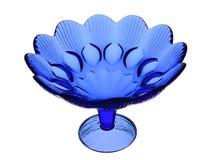 花瓶从蓝色玻璃的一个色拉盘在白色背景 库存照片