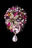 以花的形式五颜六色的宝石别针别针 库存照片