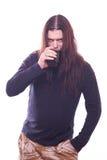 花花公子用流动的头发饮料啤酒 库存照片