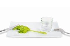 芹菜和杯词根水 库存照片