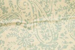 苍白佩兹利起皱纹的织地不很细背景 库存照片