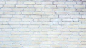 苍白砖墙 免版税库存照片