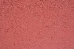 苍白红色墙壁表面 库存照片