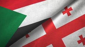 苏丹和乔治亚两旗子纺织品布料,织品纹理 皇族释放例证