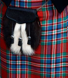 苏格兰男用短裙毛皮袋 免版税库存图片