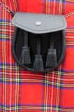 苏格兰男用短裙毛皮袋 库存照片