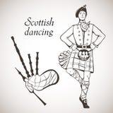 苏格兰舞蹈家和风笛 免版税库存照片
