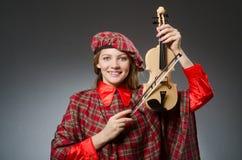 苏格兰衣物的妇女 免版税库存照片