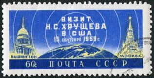 苏联- 1959年:展示美国国会大厦、地球和克里姆林宫,尼基塔・赫鲁晓夫总理参观向美国1959年9月 库存图片