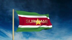苏里南旗子与标题的滑子样式 挥动  股票视频