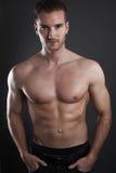 英俊男性肌肉 库存照片