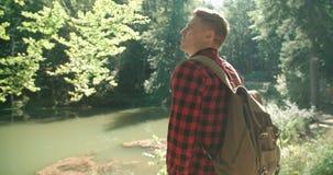 英俊的人画象在绿色自然的 免版税图库摄影