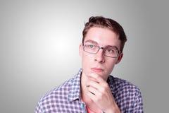 年轻英俊的人认为 免版税图库摄影