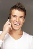 英俊的人购买权用电话 免版税库存图片