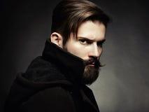英俊的人画象有胡子的 免版税库存照片