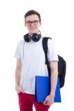 英俊的十几岁的男孩画象有在白色隔绝的背包的 免版税库存照片