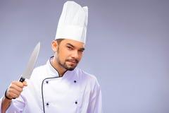 年轻英俊的厨师画象  免版税库存图片