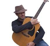 英俊的吉他弹奏者 免版税库存照片