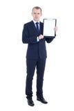英俊的商人全长画象衣服的与空白 免版税库存图片