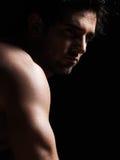 英俊的性感的露胸部的强壮男子的人画象 免版税库存图片