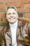 英俊的成熟白肤金发的人在他的四十年代 库存照片