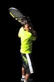 英俊的男孩用演奏反手的网球设备 免版税库存照片