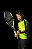 英俊的男孩画象用网球设备 库存图片