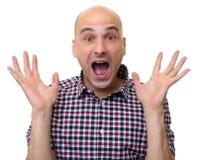 英俊的秃头人惊奇被隔绝 免版税库存图片