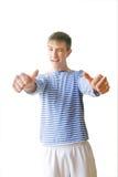 英俊的青年赞许 免版税库存图片