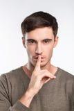 英俊的年轻人请求沈默 免版税图库摄影