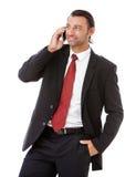英俊的年轻商人谈话在电话 库存图片