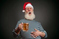 英俊的水手 海员 啤酒克劳斯・圣诞老人 库存图片