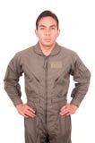 英俊的年轻男性试验佩带的制服 免版税库存照片