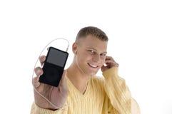 英俊的iPod人陈列 库存照片