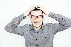 年轻英俊穿着考究人摆在情感在白色背景,生活方式人概念 免版税图库摄影